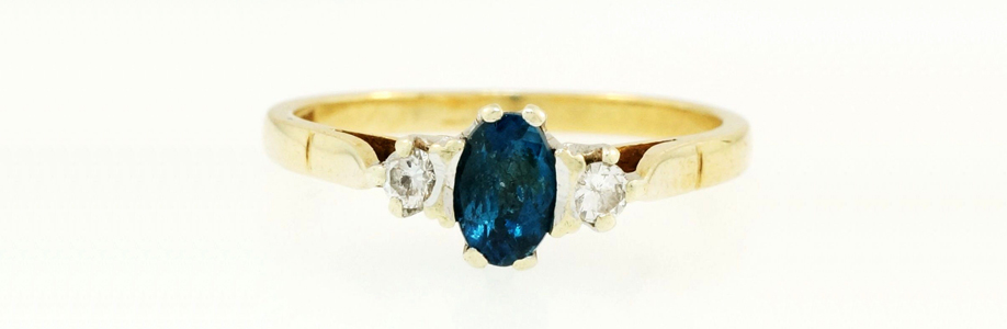 9Ct Yellow Gold Blue Topaz Solitaire w/Simulated Diamonds Ring